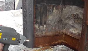 Einen alten Kamin vom Rost befreien